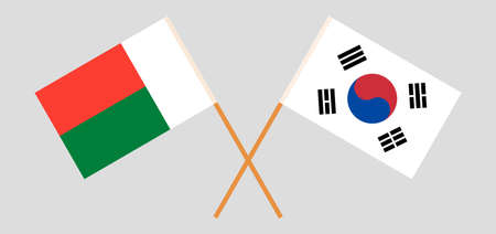Crossed flags of Madagascar and South Korea. Official colors. Correct proportion. Vector illustration