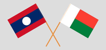 Crossed flags of Madagascar and Laos. Official colors. Correct proportion. Vector illustration