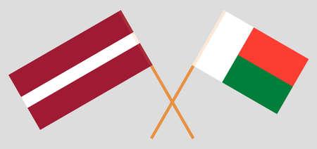 Crossed flags of Madagascar and Latvia. Official colors. Correct proportion. Vector illustration Vektoros illusztráció