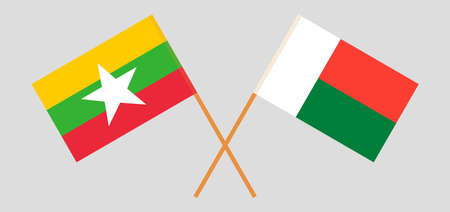 Crossed flags of Madagascar and Myanmar. Official colors. Correct proportion. Vector illustration