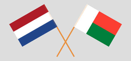 Crossed flags of Madagascar and the Netherlands. Official colors. Correct proportion. Vector illustration Çizim