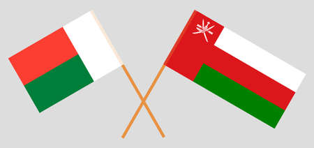Crossed flags of Madagascar and Oman. Official colors. Correct proportion. Vector illustration Иллюстрация