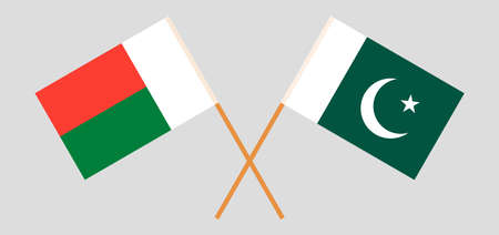 Crossed flags of Madagascar and Pakistan. Official colors. Correct proportion. Vector illustration Иллюстрация