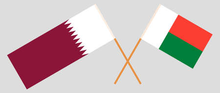 Crossed flags of Madagascar and Qatar. Official colors. Correct proportion. Vector illustration