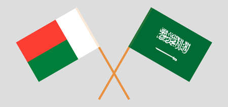 Crossed flags of Madagascar and the Kingdom of Saudi Arabia. Official colors. Correct proportion. Vector illustration
