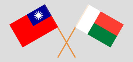 Crossed flags of Madagascar and Taiwan. Official colors. Correct proportion. Vector illustration
