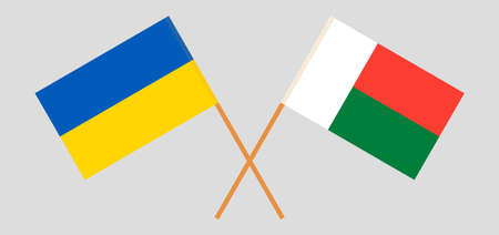 Crossed flags of Madagascar and the Ukraine. Official colors. Correct proportion. Vector illustration