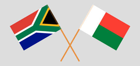 Crossed flags of Madagascar and the RSA. Official colors. Correct proportion. Vector illustration