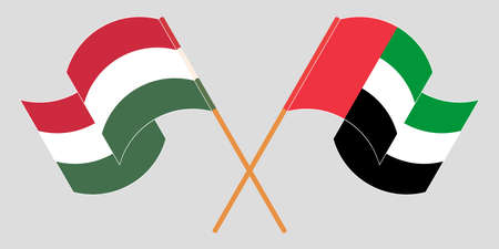 Crossed and waving flags of Hungary and the United Arab Emirates. Vector illustration