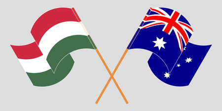 Crossed and waving flags of Hungary and Australia. Vector illustration