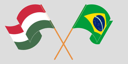 Crossed and waving flags of Hungary and Brazil. Vector illustration Ilustracja