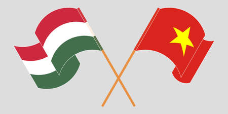 Crossed and waving flags of Hungary and Vietnam. Vector illustration