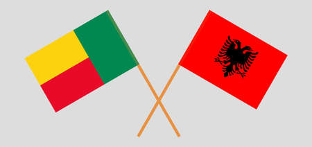 Crossed flags of Benin and Albania. Official colors. Correct proportion. Vector illustration 向量圖像