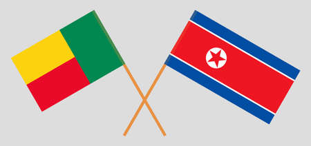 Crossed flags of Benin and North Korea. Official colors. Correct proportion. Vector illustration