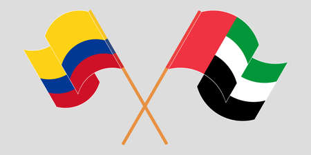 Crossed and waving flags of Colombia and the United Arab Emirates