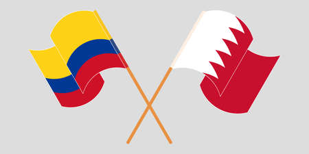 Crossed and waving flags of Colombia and Bahrain
