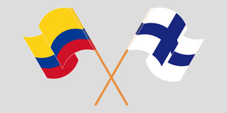 Crossed and waving flags of Colombia and Finland