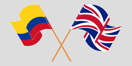 Crossed and waving flags of Colombia and the UK
