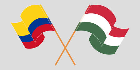 Crossed and waving flags of Colombia and Hungary