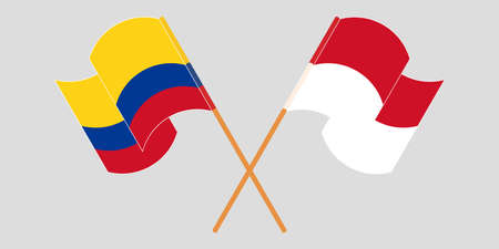Crossed and waving flags of Colombia and Indonesia