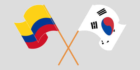 Crossed and waving flags of Colombia and South Korea
