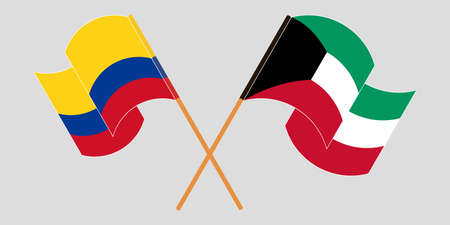 Crossed and waving flags of Colombia and Kuwait