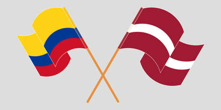 Crossed and waving flags of Colombia and Latvia