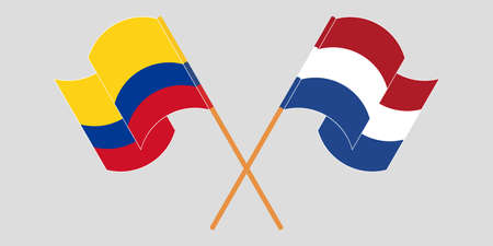 Crossed and waving flags of Colombia and the Netherlands