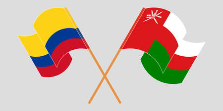 Crossed and waving flags of Colombia and Oman