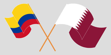 Crossed and waving flags of Colombia and Qatar