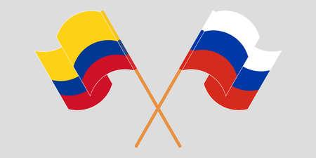 Crossed and waving flags of Colombia and Russia