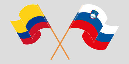 Crossed and waving flags of Colombia and Slovenia