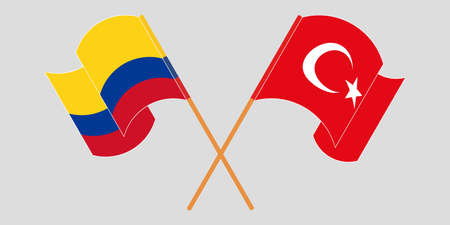 Crossed and waving flags of Colombia and Turkey