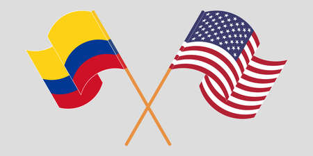 Crossed and waving flags of Colombia and the USA