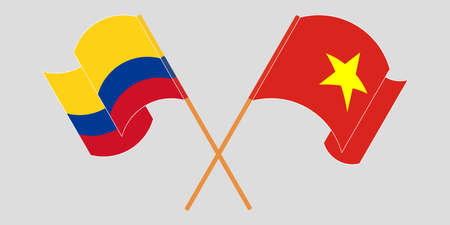 Crossed and waving flags of Colombia and Vietnam