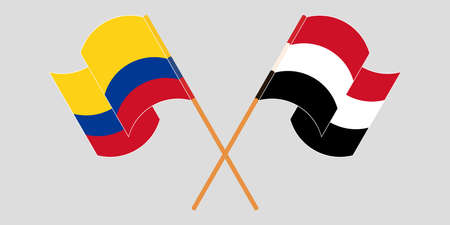 Crossed and waving flags of Colombia and Yemen