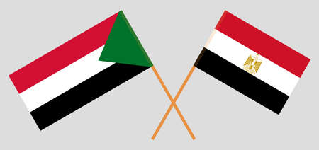 Crossed flags of Egypt and Sudan