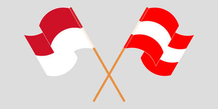 Crossed and waving flags of Indonesia and Austria