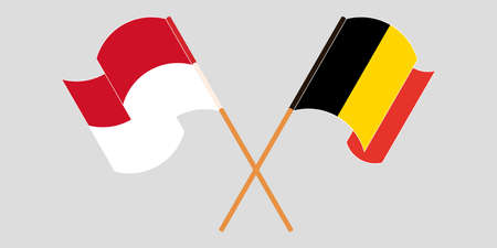 Crossed and waving flags of Indonesia and Belgium