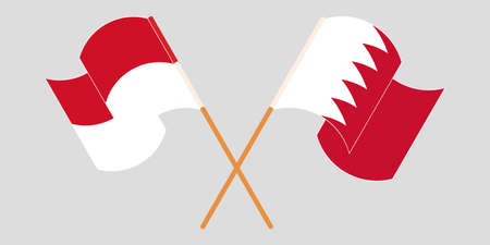 Crossed and waving flags of Indonesia and Bahrain