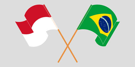 Crossed and waving flags of Indonesia and Brazil