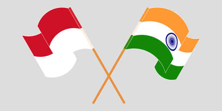 Crossed and waving flags of Indonesia and India