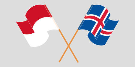 Crossed and waving flags of Indonesia and Iceland