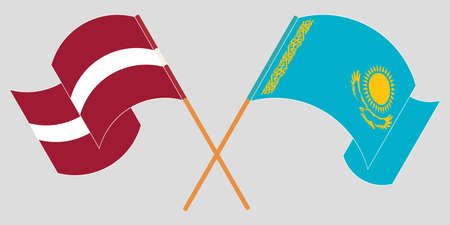 Crossed and waving flags of Kazakhstan and Latvia