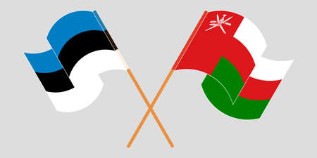 Crossed and waving flags of Oman and Estonia