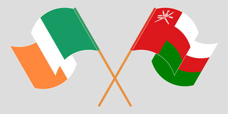 Crossed and waving flags of Oman and Ireland 矢量图像