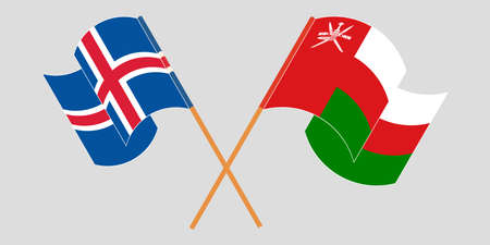 Crossed and waving flags of Oman and Iceland