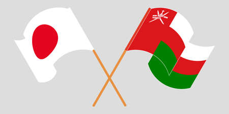 Crossed flags of Oman and Japan