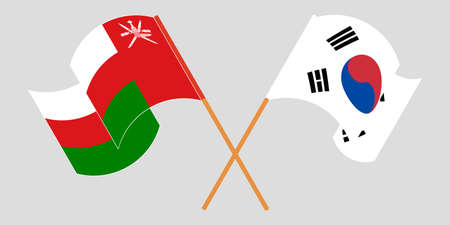 Crossed flags of Oman and South Korea
