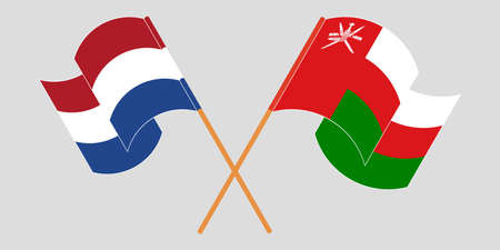 Crossed and waving flags of Oman and the Netherlands